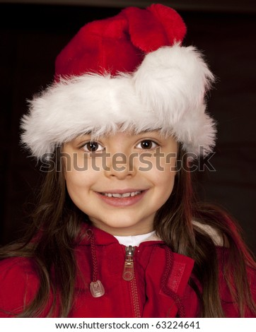 Girl in red hat on black background