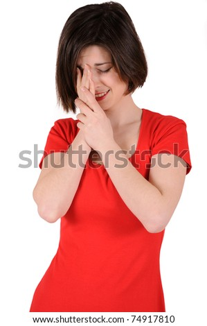 girl in red is crying, isolated on white - stock photo