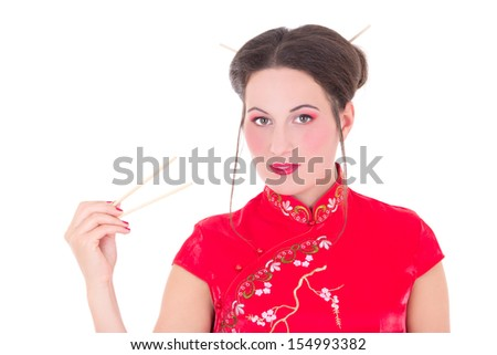 girl in red japanese dress with chopsticks isolated on white background