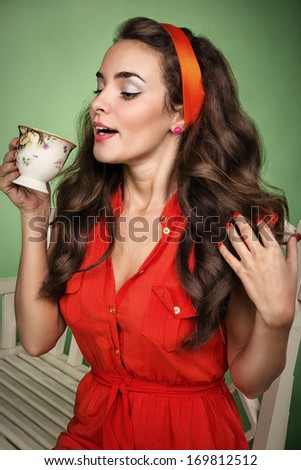 Girl in retro style drinks tea