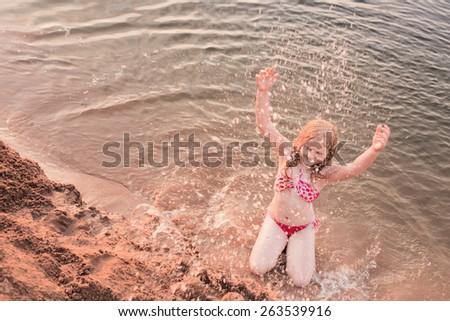 girl in sandy beach - stock photo