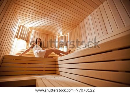 Girl in sauna - stock photo