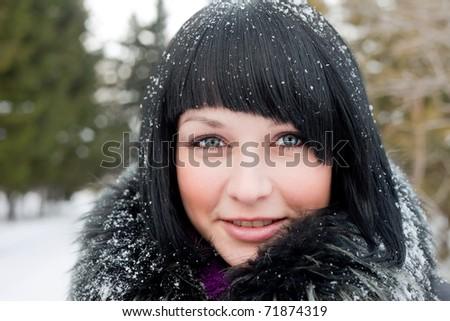 girl in snowflake look at camera smiling - stock photo