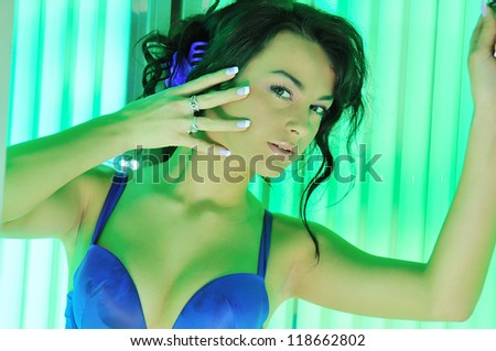 girl in solarium - stock photo