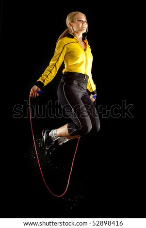 girl in sport a skipping rope - stock photo