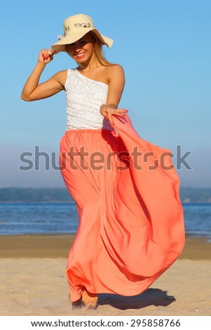 girl in summer dress on a background of the sea - stock photo