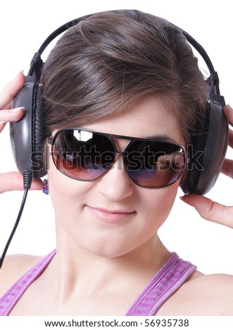 Girl in Sunglasses and headphones on white background (isolated, clipping path)