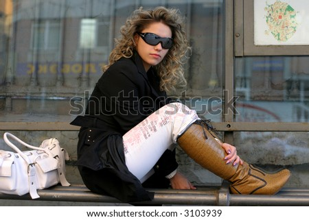 girl in sunglasses are sitting on stop