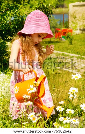 Girl in sunny summer garden - stock photo