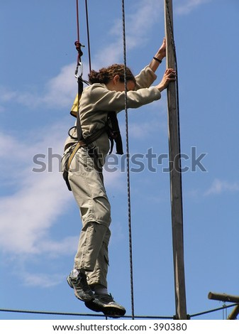 Girl in the air, lifted on a rope