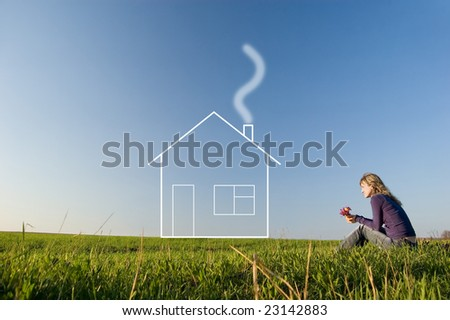 Girl in the field smells a bunch of flowers and dreams of the house - stock photo