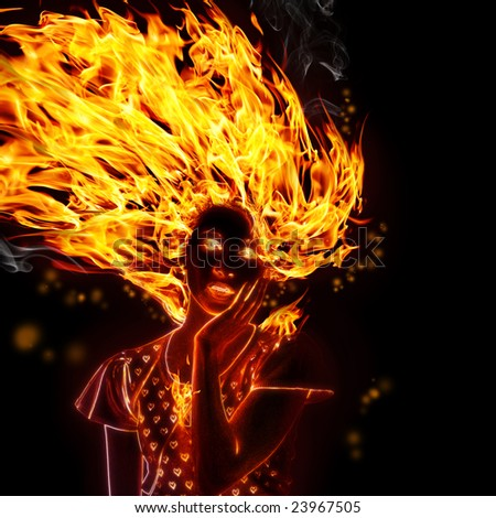 Girl in the fire on black background - stock photo