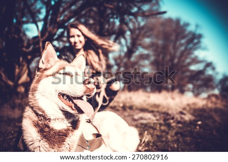 Girl in the forest with her husky dog - stock photo