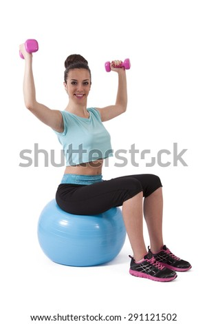 girl in the gym with weights and ball