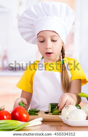 Girl in the kitchen starts to cook, food on the table