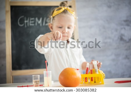 Girl in the laboratory of food quality tests - stock photo