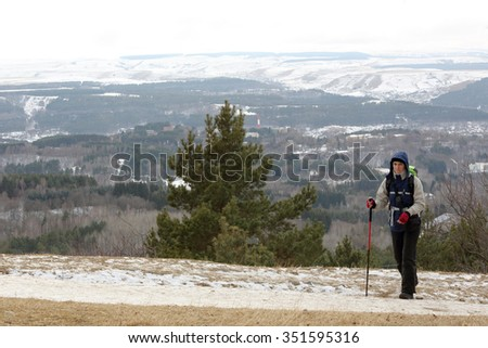 Girl in the mountains, North Caucasus, Russia. - stock photo