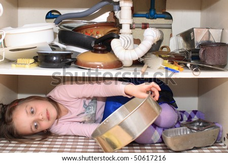 girl in the old kitchen box - stock photo