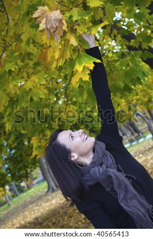 Girl in the park - autumn time. - stock photo