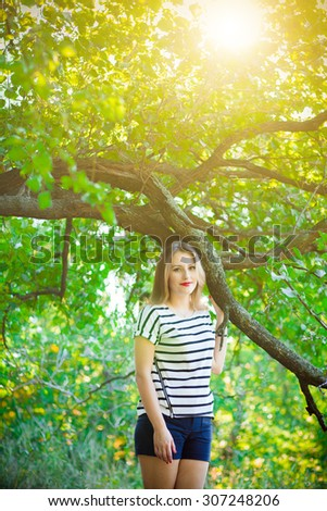 girl in the park the sun light in park - stock photo