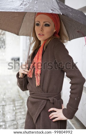 Girl in the Rain - stock photo