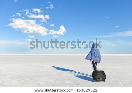 Girl in travel with a vast white salt flats background in Bonneville, Utah - stock photo