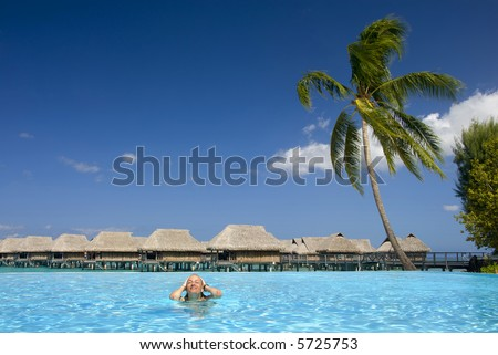 Girl in tropical swimming pool