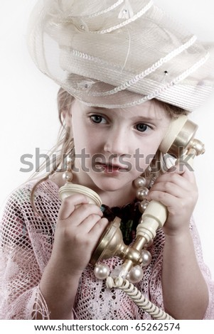 Girl in vintage hat talking on phone