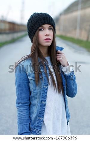 Girl in warm cap outdoor, fashion - stock photo