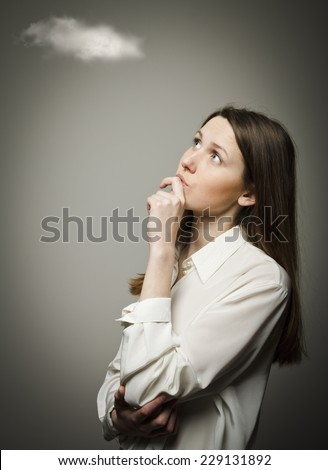 Girl in white and cloud. Imagination concept. Girl is thinking. - stock photo