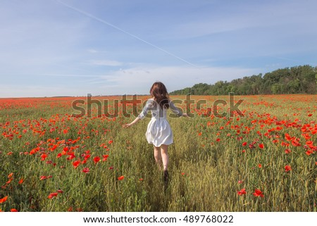 girl in white dress in the poppy field