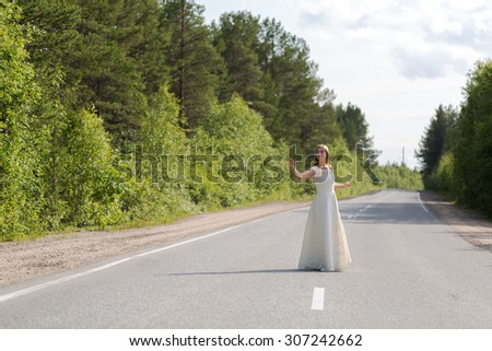 girl in white dress on the road - stock photo