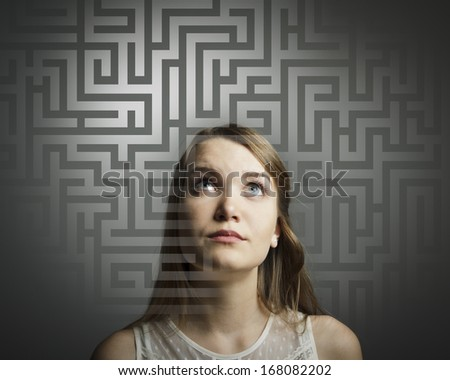 Girl in white full of doubts and hesitation. Girl looking for the solution. - stock photo