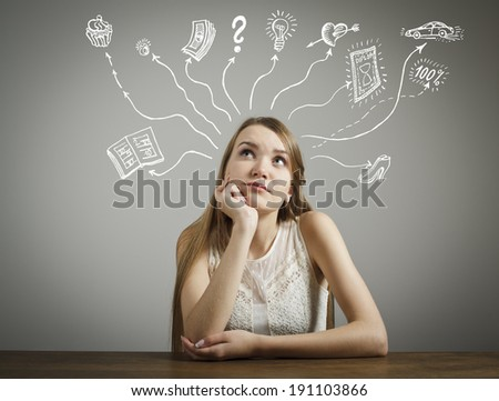 Girl in white is dreaming about something. - stock photo