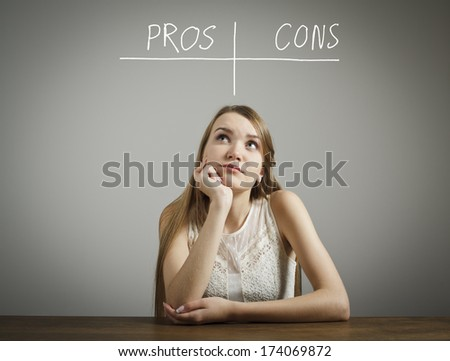 Girl in white is thinking. Pros and cons concept. - stock photo