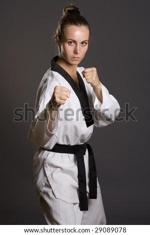 girl in white kimono ready to fight - stock photo