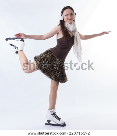 girl in white scarf and headphones posing on skates