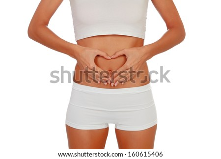 Girl in white underwear forming a heart with her hands on her belly isolated - stock photo