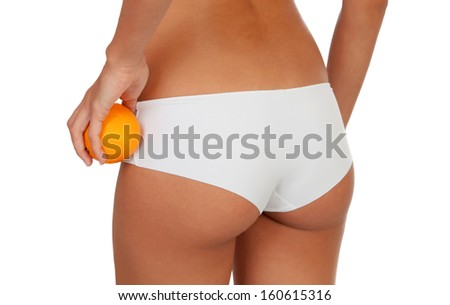 Girl in white underwear with a orange isolated