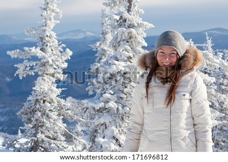 girl in winter forest - stock photo