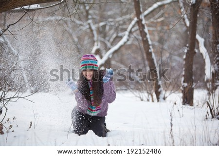 Girl in winter forest fun - stock photo