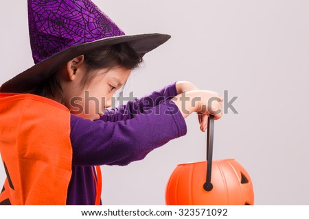 Girl in Witch Costume on White / Girl in Witch Costume / Girl in Witch Costume, Studio Shot - stock photo