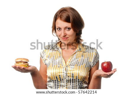 Girl is chosen between apple and hamburger - stock photo