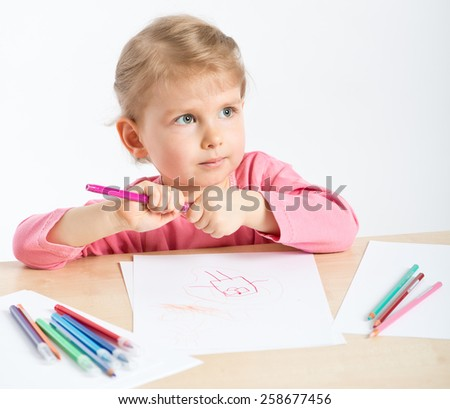 Girl is drawing with felt-tip pen - stock photo