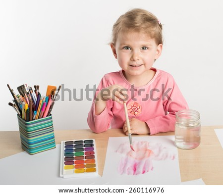 Girl is drawing with watercolor - stock photo