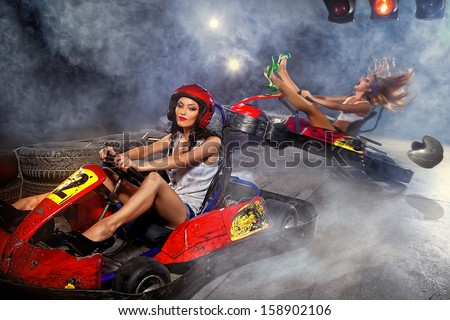 girl is driving Go-kart with speed in Carting   - stock photo