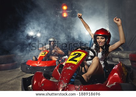 girl is driving Go-kart with speed in Karting   - stock photo