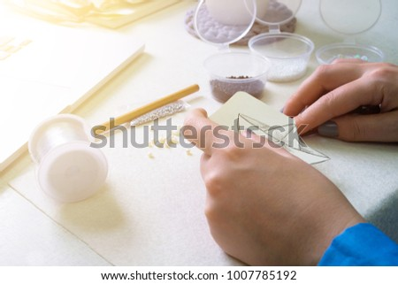 Girl is engaged in creative activity