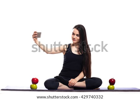 Girl is engaged in yoga on a white background, selfie photo,  - stock photo