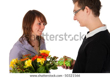 Girl is getting present and flowers from her boyfriend